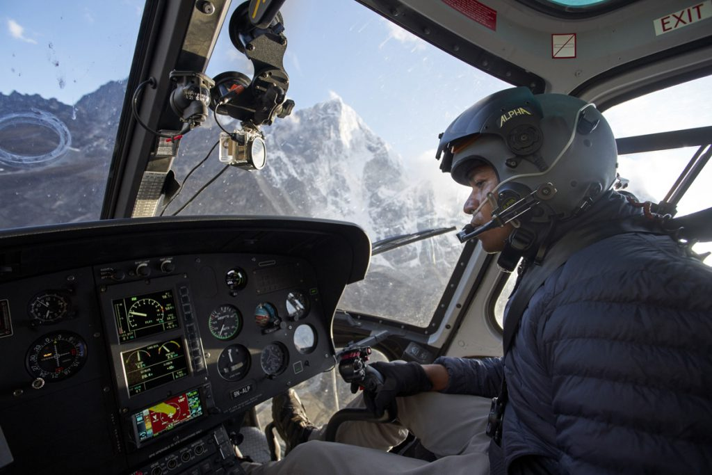 Simrik Air pilot Surrendra Poudel flies his helicopter on a rescue mission over Everest Base Camp, Nepal.