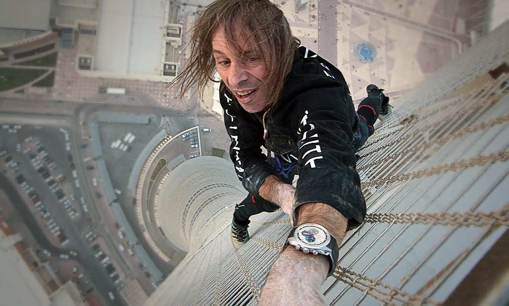 ***Exclusive Allrounder*** Alain Robert, also known as the french Spiderman, climbs the tallest building in Qatar. The Aspire Tower (or Torch Tower) is a 318 metre tall skyscraper, located in the Doha Sports City complex in Doha. Mandatory Credit: WENN.com